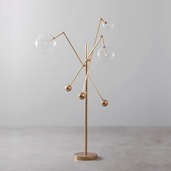 Natural brass industrial style floor lamp with 3 angular arm design with clear glass globe lampshades