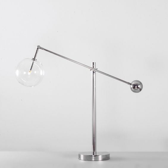 Industrial table lamp with clear glass globe lampshade in a polished nickel finish made from solid brass