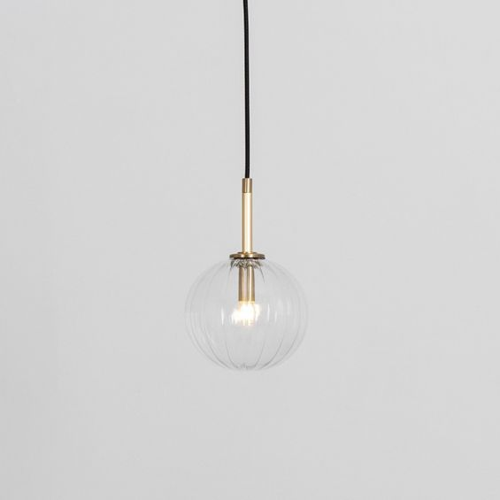 Textured clear glass globe pendant ceiling light with natural brass fixture