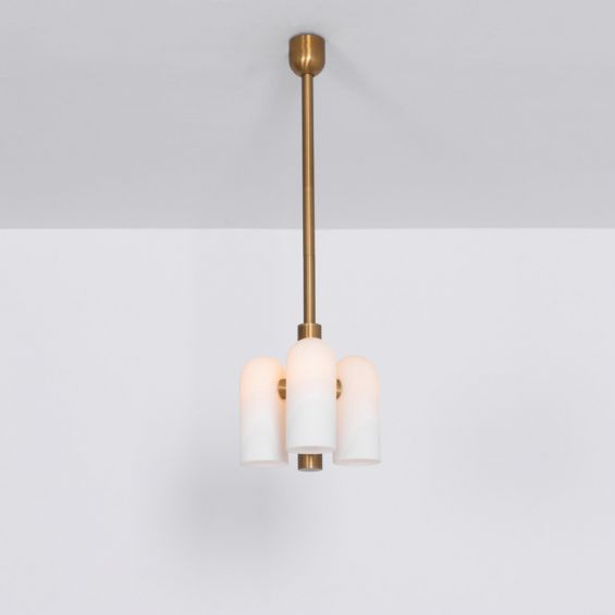 Contemporary retro style pendant ceiling light in a natural brass finish with translucent glass lampshade design