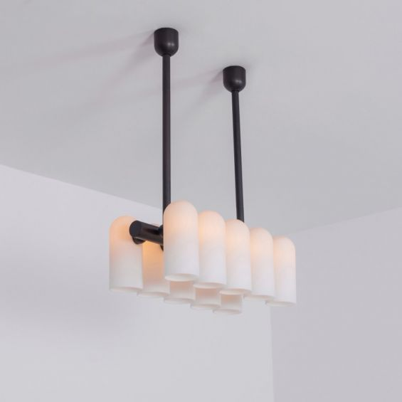 Black gunmetal finish solid brass chandelier with a parallel row of translucent glass shades