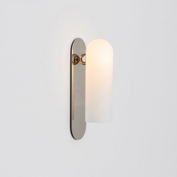 Contemporary solid brass wall lamp in a polished nickel finish with a long translucent glass lampshade