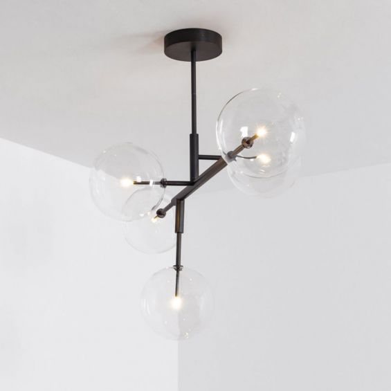A chic and sophisticated black gunmetal LED pendant with transparent glass lampshades