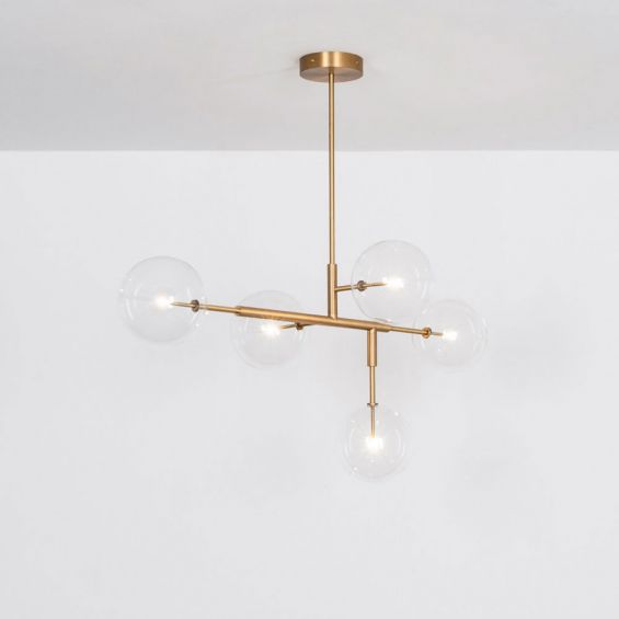 A luxurious lacquered burnished brass LED pendant with transparent glass lampshades