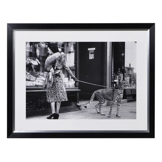 black and white print of lady with her cheetah