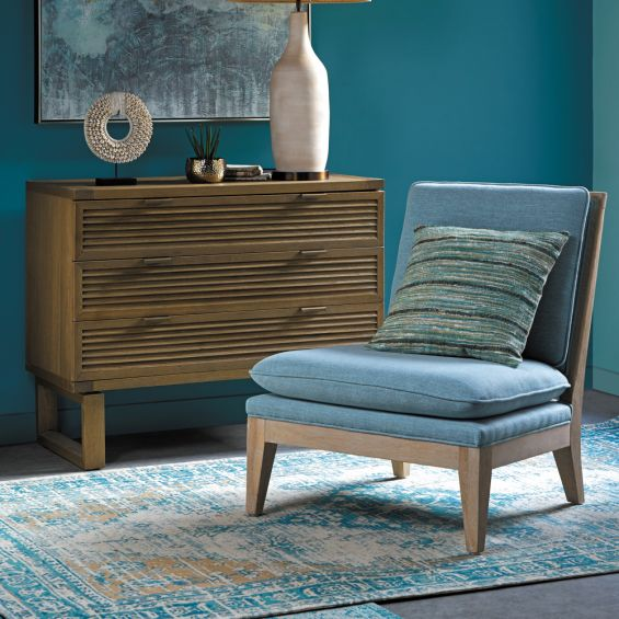 A beautiful blue lounge chair with a weathered natural ash frame