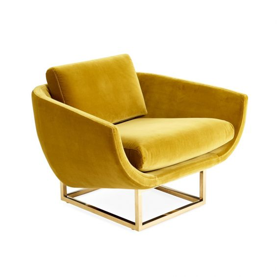 A luxurious golden-yellow velvet-upholstered lounge chair with a brushed brass base