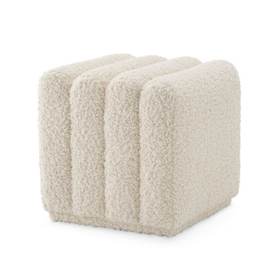 A luxurious, faux shearling Bente stool by Eichholtz
