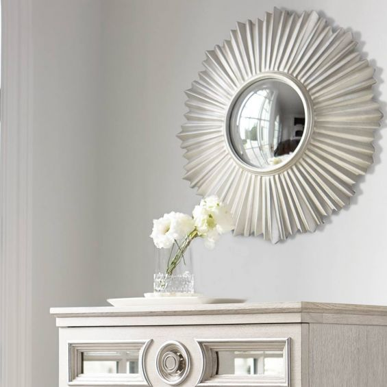 A beautiful wall mirror from Bernhardt with a unique star edge and stunning silver finish