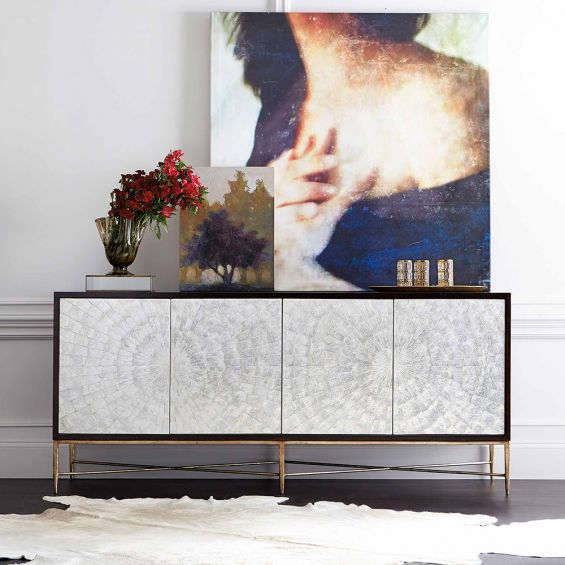 A mesmerising expresso coloured sideboard with an iridescent bronze finish, two pairs of doors, a removable shelf and three drawers