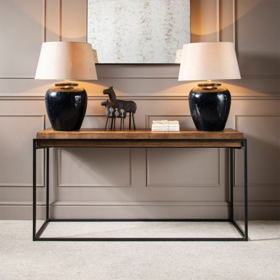 An elegant glazed table lamp with a contrasting linen shade