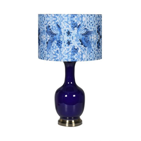 Shiny blue table lamp with blue patterned lamp shade on brass base