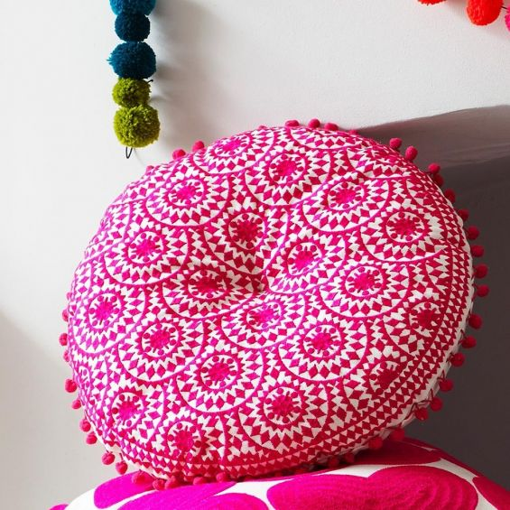 Round embroidered fuschia bohemian patterned cushion