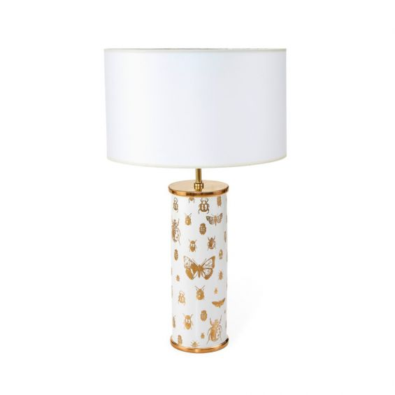 A stylish white and gold table lamps with bug details