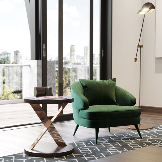 A luxurious retro-style velvet armchair with upholstered wooden legs by Laskasas. Pictured in Green.
