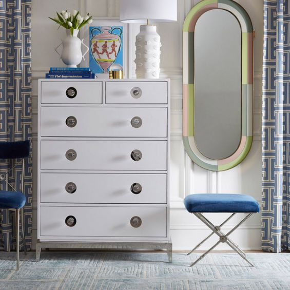 A glamorous Hollywood-inspired six drawer chest with acrylic and nickel details