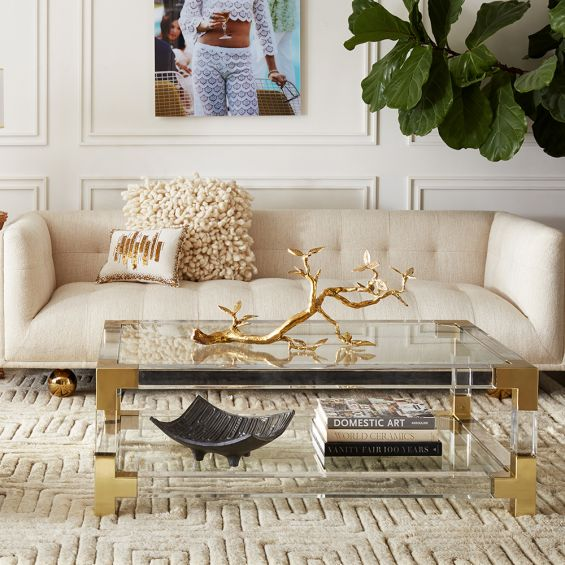 stylish, contemporary sofa with rounded feet and stone-coloured fabric