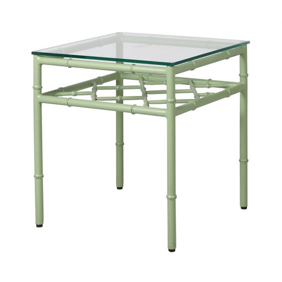An outdoor sage green side table with a glass surface