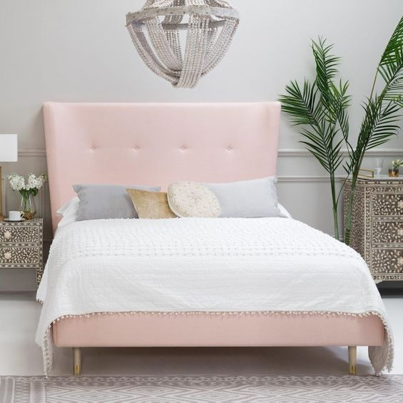 Luxury Scandinavian style bed with soft edges and curves, on wooden tapered legs