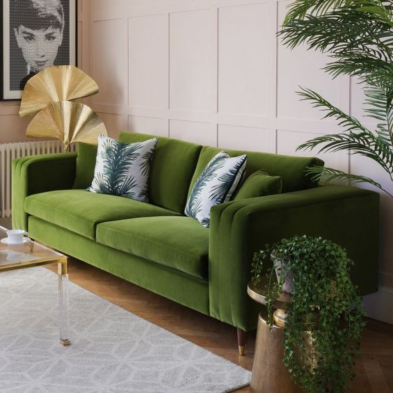 Unique green velvet sofa with fluted oversized arms and gold capped feet