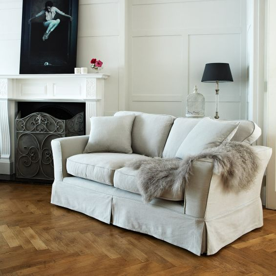 Classic, luxury designer sofa with loose covers in luxury grey linen