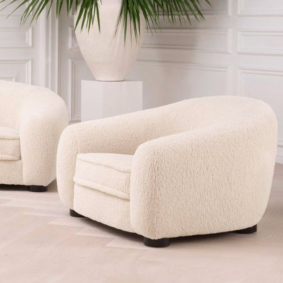 A luxurious enveloping cosy and fluffy armchair by Eichholtz