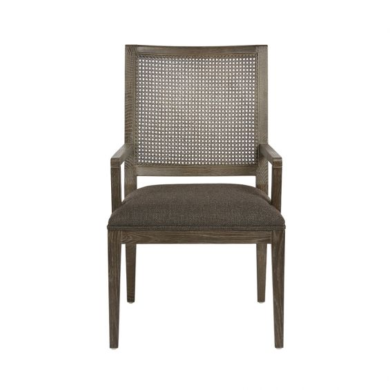 brown armchair with caned back and padded polyester seat