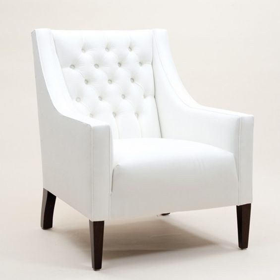 Classic buttoned back armchair with a deep cushion and piping