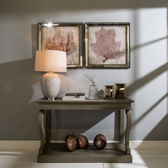 An elegant ceramic table lamp with a crackle glaze finish and matching lampshade