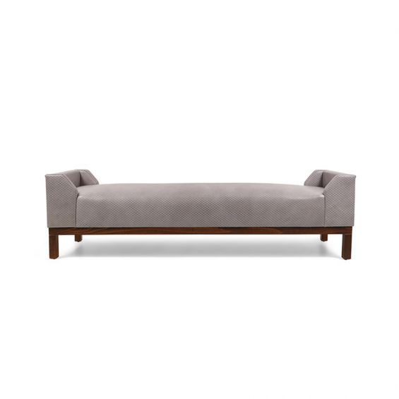 A modern bench with taupe upholstery and a wooden base