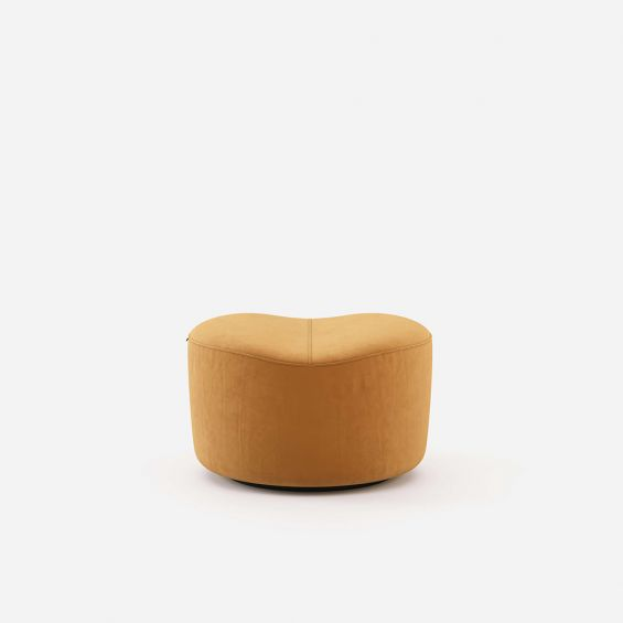 A stylish art deco-inspired ottoman stool with suede upholstery