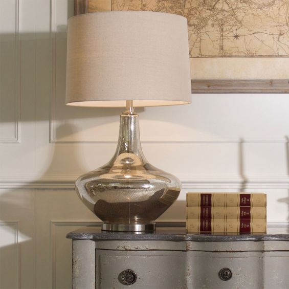 A luxurious side lamp with a crackle glaze finish and a natural linen shade