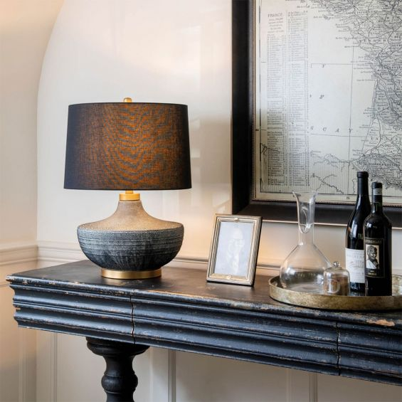 A fabulously textured table lamp with a black linen shade
