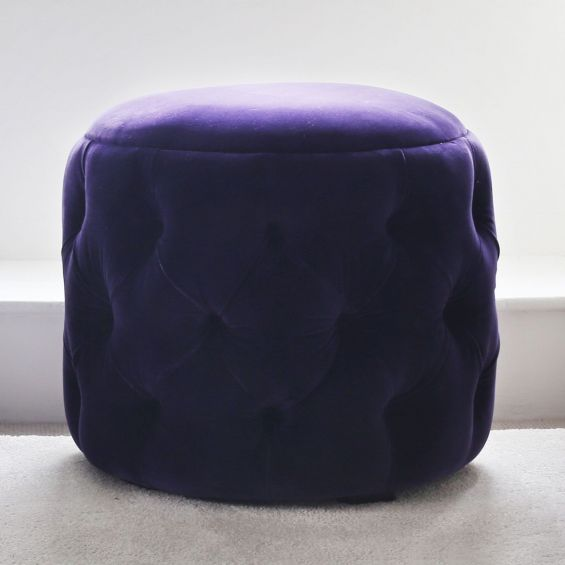 Luxury, deep buttoned upholstered pouffe with flat top seat