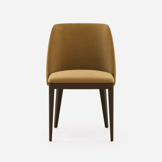 A luxurious modern dining chair with wooden legs and golden accents