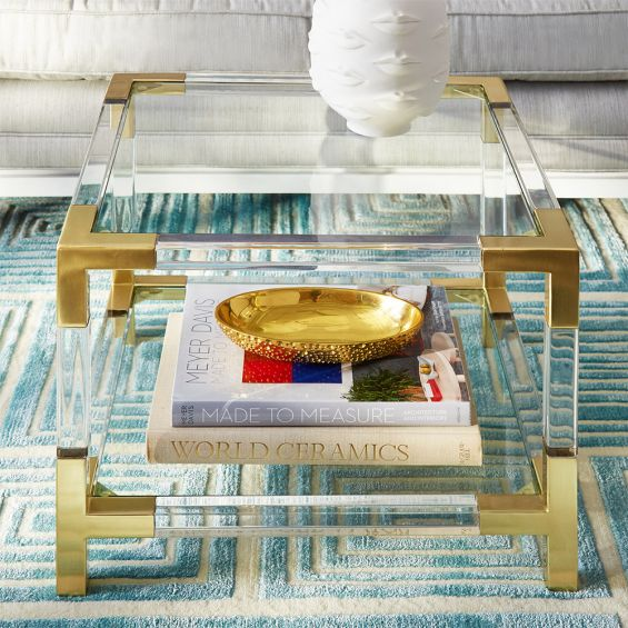 A stylish brass and acrylic accent table