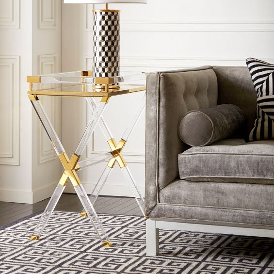A luxurious acrylic and brass tray table by Jonathan Adler