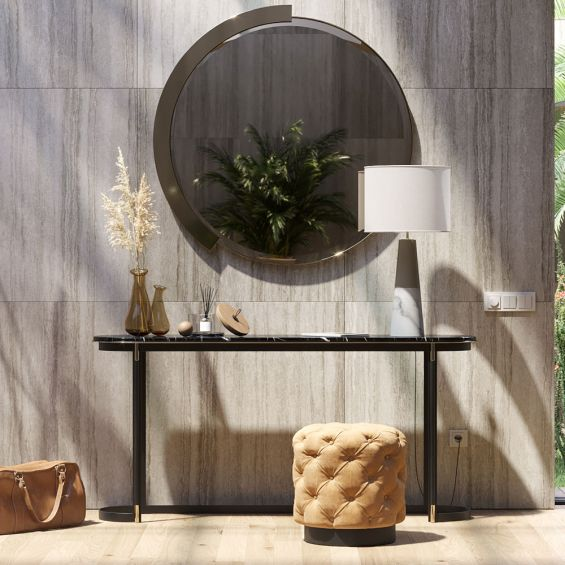 a luxurious modern console table with a marble surface and golden accents