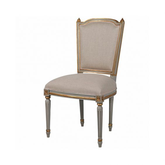 luxurious dining chair with ornate details and brass-effect accents