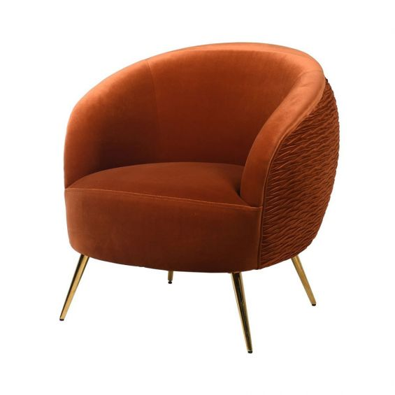 round burnt orange accent chair with brass-effect tapered legs