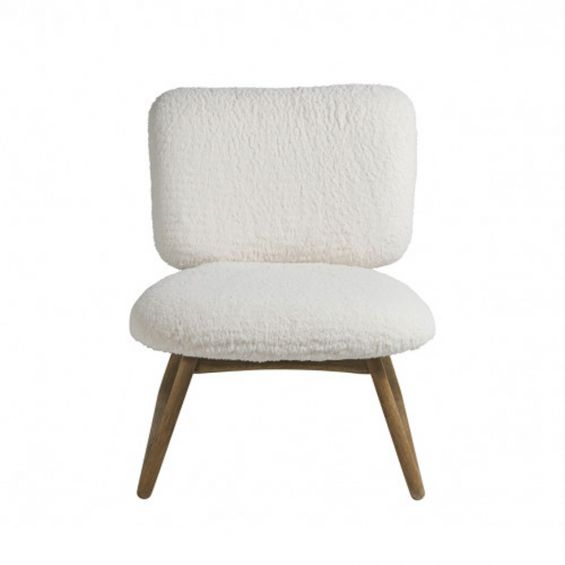 A luxurious faux shearling armchair with natural oak frame