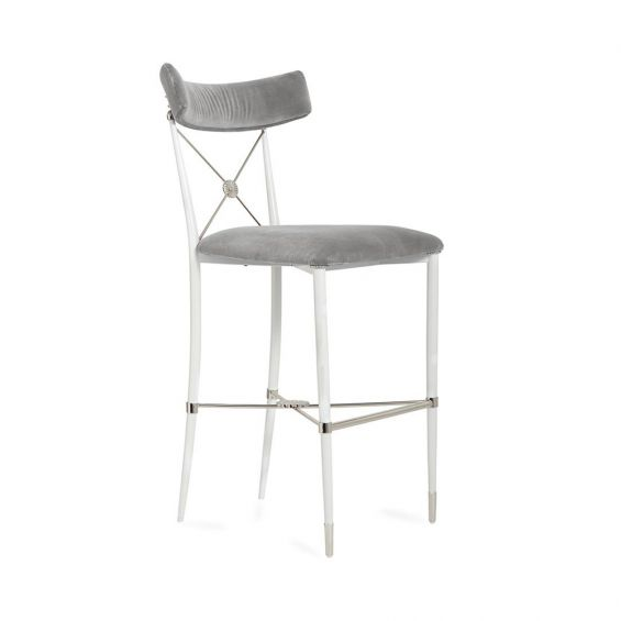 A chic empire-style counter stool in luscious, grey velvet