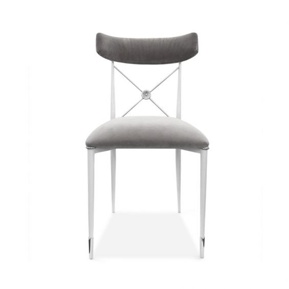 A chic grey velvet dining chair with a white metal frame