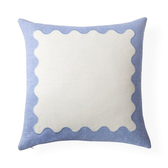 A playful modern blue and white ripple cushion with hand-embroidered details