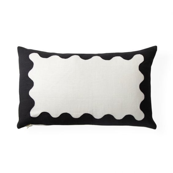 A stylish monochromatic ripple cushion with hand-embroidered details