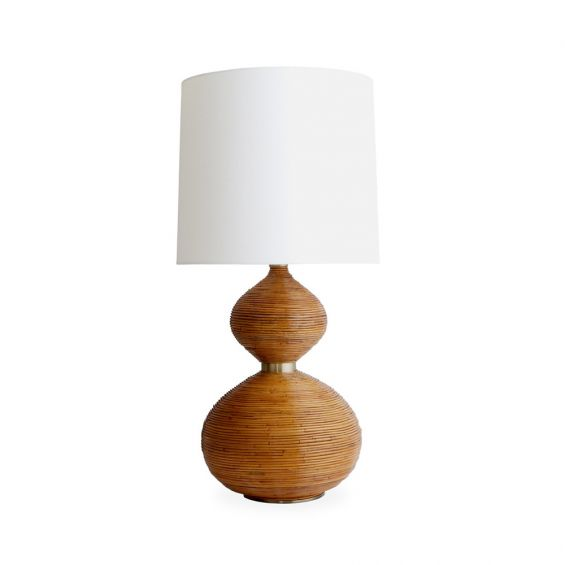 A luxurious honey-toned rattan table lamp with a white lampshade