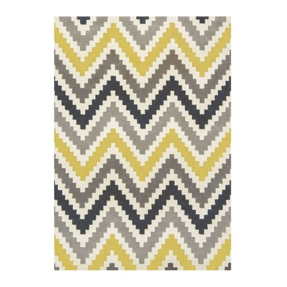 Hand-tufted wool rug with chevron pattern in yellow