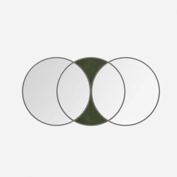 A glamorous art deco-inspired wall mirror with green velvet