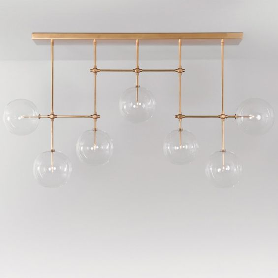 Natural brass industrial style chandelier with hanging clear glass globes