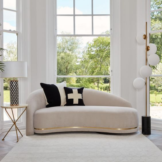 A luxurious Art Deco-inspired sofa with brass-effect detailing. Pictured in COM